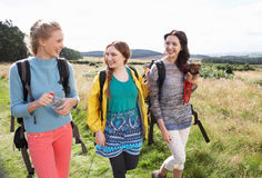 Group Of Teenage Girls Hiking In Countryside With Dog Stock Photography