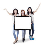 Group of teenage girls holding a blank board Royalty Free Stock Photography