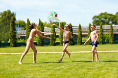 Group of teenage kids playing with ball on summer  Stock Image