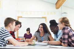 Group Of Teenage Students Collaborating On Project In Classroom. Teenage Students Collaborating On Project In Classroom royalty free stock photo