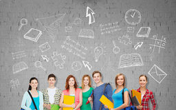 Group of teenage students with folders and bags Stock Images