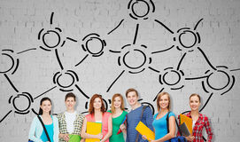 Group of teenage students with folders and bags Royalty Free Stock Photo