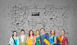 Group of teenage students with folders and bags royalty free stock image