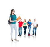 Group of teenage students isolated on white. Background. Many different people standing together. School, education, college, university concept Stock Photos