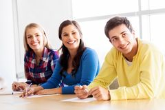 Group of teenage students at school classroom royalty free stock images