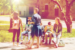 Group of teenage students at school yard Stock Image