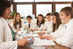 Group Of Teenage Students In Science Class Royalty Free Stock Images