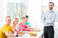 Group of teenage students studying at the lesson Royalty Free Stock Photo