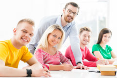 Group of teenage students studying at the lesson Royalty Free Stock Image