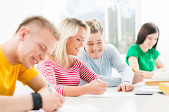 Group of teenage students studying at the lesson in the classroom Stock Photography