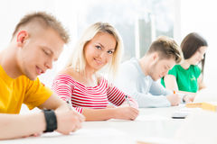 Group of teenage students studying at the lesson in the classroom Royalty Free Stock Photos