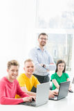 Group of teenage students studying at the lesson in the classroom Royalty Free Stock Photo