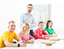 Group of teenage students studying at the lesson in the classroom.  Royalty Free Stock Photography