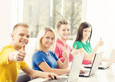 Group of teenage students and a teacher at the lesson in the cla. Ssroom. Education, school, college and university concept. Hipster color Stock Photography