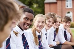 Group Of Teenage Students In Uniform Outside School Buildings stock photography