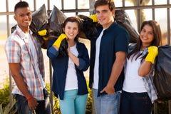 Group teenage volunteers. Group of smiling teenage volunteers with garbage bags after cleaning the streets stock photo
