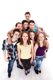 Group of teenager friends. Happy smiling group of young friends standing and embracing together, top view Royalty Free Stock Photography