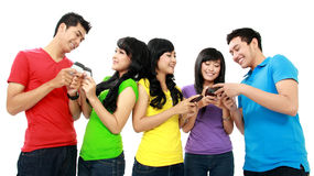 Group of Teenager Friends. Playing with phone Royalty Free Stock Photos