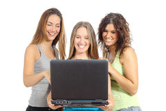 Group of teenager girls browsing internet in a laptop stock images