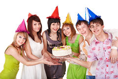 Group teenager in party hat. Group teenager in party hat with cake. Isolated Royalty Free Stock Image