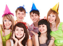 Group of teenager in party hat. Isolated Stock Photo
