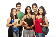 Group of Teenager Student. Group of young teenager students standing and smiling with books and bags over white background royalty free stock image