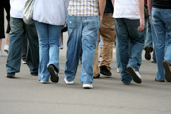 Group of teenagers. Walking in the street stock image
