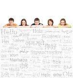 Group of teenagers on a background of words. Group of teenagers on a background of many words from the different languages (language school concept Royalty Free Stock Photography