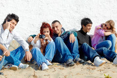 Group of teenagers on the beach Stock Images