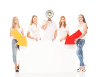 Group of teenagers with a blank, white billboard Royalty Free Stock Images