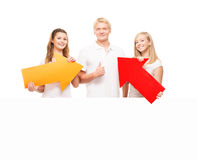 Group of teenagers with a blank, white billboard. Isolated on white Royalty Free Stock Images