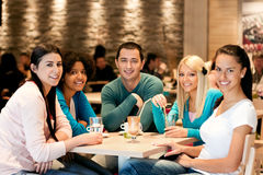 Group of teenagers in cafe. Group of teenagers in café, students leisure activities leisure activities Stock Image