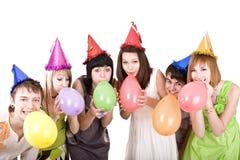 Group of teenagers celebrate birthday.