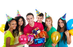Group of teenagers celebrate birthday over white. Group of teenagers celebrate birthday. Isolated over white  background Royalty Free Stock Images