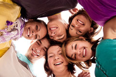 Group of teenagers in circle stock photos