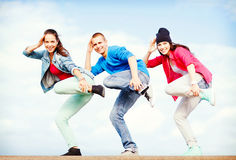 Group of teenagers dancing Stock Image