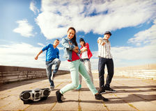 Group of teenagers dancing Stock Images