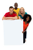 Group of teenagers displaying white banner Royalty Free Stock Photos