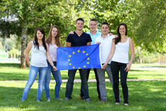 Group of teenagers and flag Royalty Free Stock Image