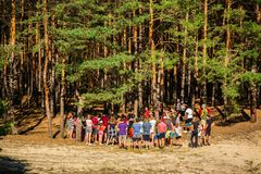Group of Teenagers in Forest wide. Kyiliv, Kyiv region, Ukraine - 08 09 2017: A group of young people teenagers in a pine forest play rest are competing Royalty Free Stock Photo
