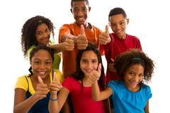 Group of teenagers giving thumbs up Royalty Free Stock Photos