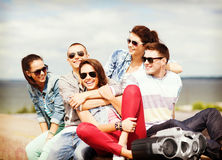 Group of teenagers hanging out Royalty Free Stock Photos