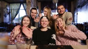 Group of teenagers hanging out and waving hands Royalty Free Stock Images