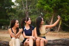 Teenagers taking selfies. stock photography