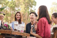 Group of 6 teenagers having fun together without liquor in cafe. In afternoon drink milk tea, pink milk and chocolate in plastic glass Stock Images