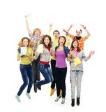 A group of teenagers holding books up Stock Photo