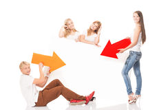 Group of teenagers holding colorful arrows on white Royalty Free Stock Photo