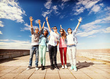 Group of teenagers holding hands up Stock Photos