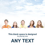 A group of teenagers holding a large white banner Stock Photography