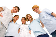 Group of teenagers in huddle. On white background Stock Image